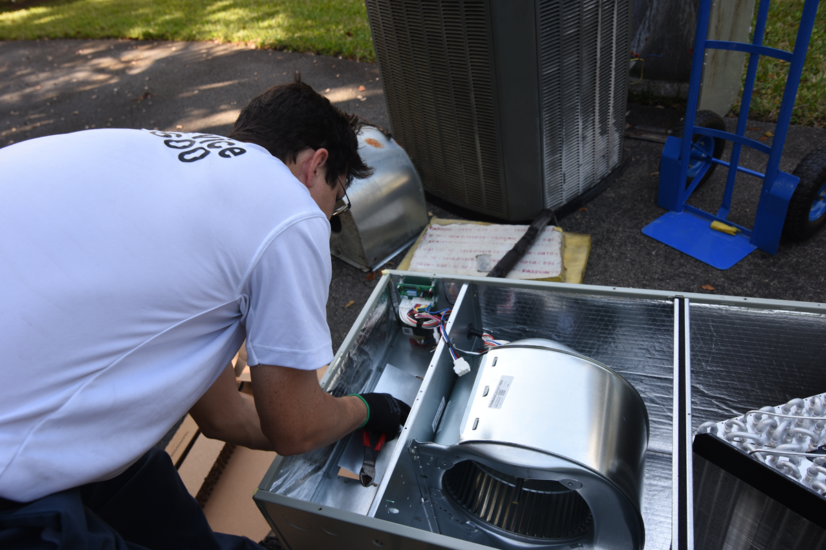 HVAC Technichian modifying an ac unit in Kendall